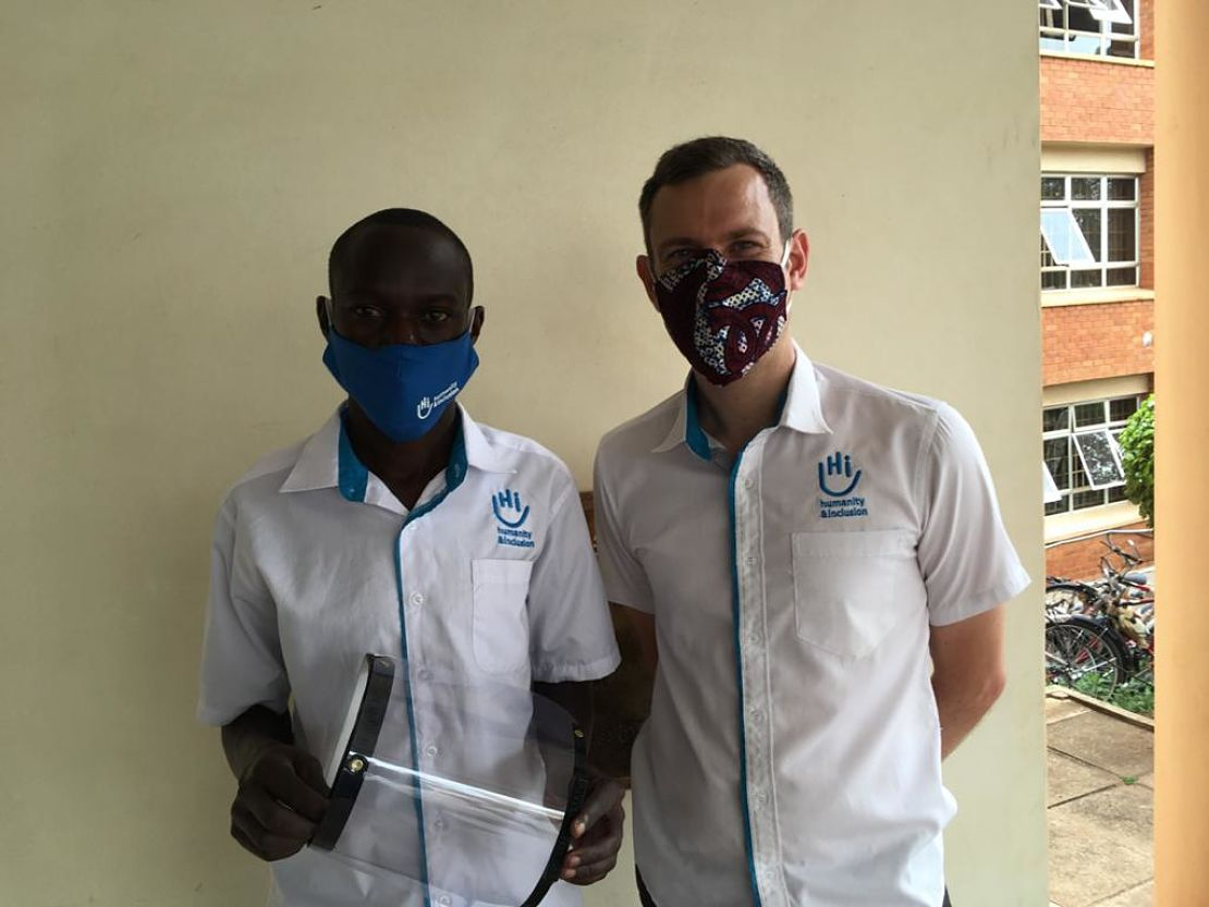 Disan, left, HI 3D Technician, with a finished 3D printed face shield, Arua Uganda Cover Image