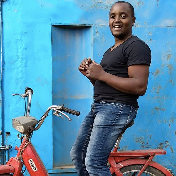 Lincoln Wamae in one of his scooters Cover Image