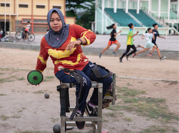 Rusmiyati, discus thrower & member of National Paralympic Committee Chapter Banjarmasin, Indonesia Cover Image